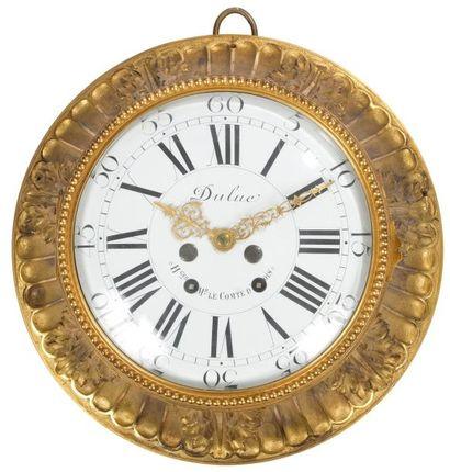 Cartel circulaire en bronze doré à décor...