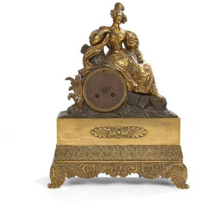 Pendule en bronze verni à décor d'une femme...