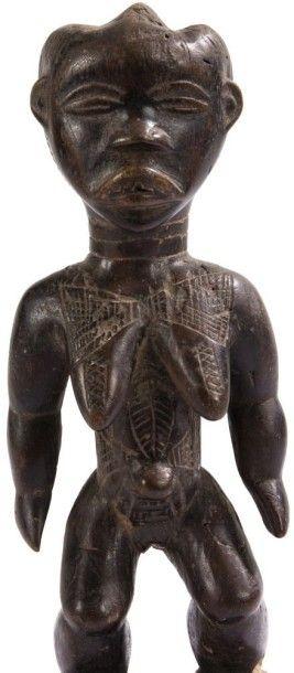 DAN (R. CÔTE d'IVOIRE) Statuette Belle sculpture féminine, bien campée sur des jambes...