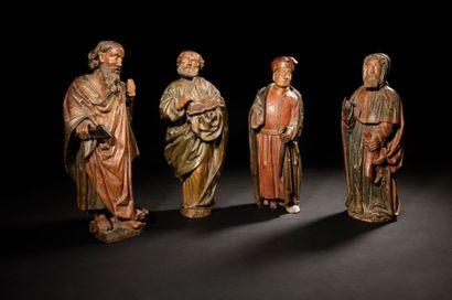 Quatre statuettes en bois sculpté et polychromé...