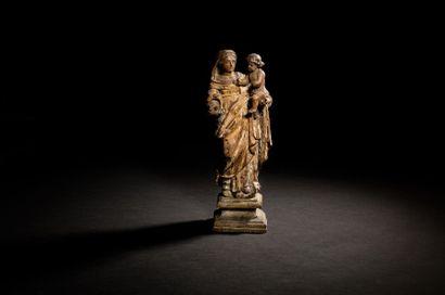 Vierge à l'Enfant en bois sculpté et doré....
