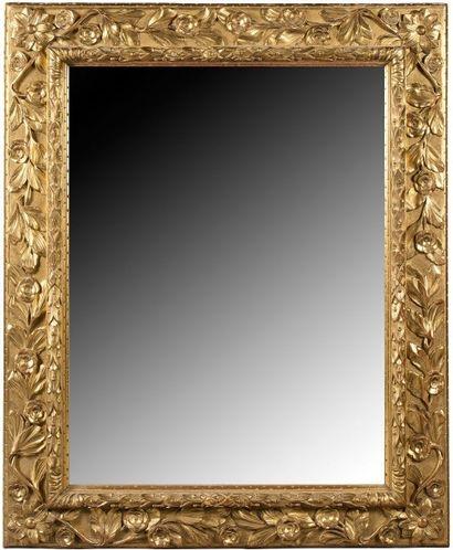 Miroir en bois doré de forme rectangulaire,...