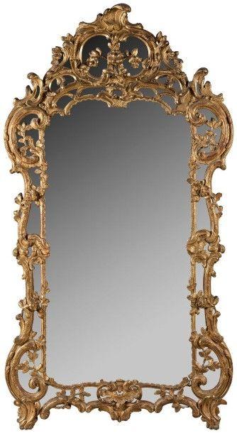 Grand miroir en bois doré, à décor ajouré...