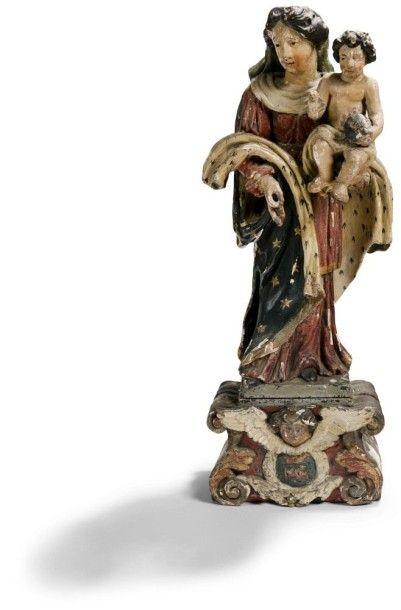 Vierge à l'Enfant en chêne sculpté et polychromé....