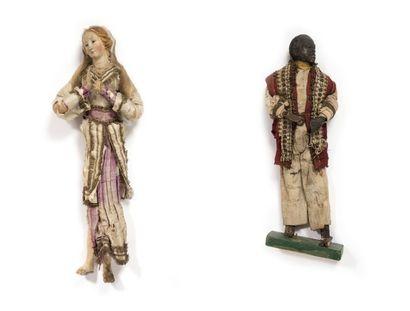 Deux santons napolitains représentant: - Une sainte femme en terre cuite et étoupe....