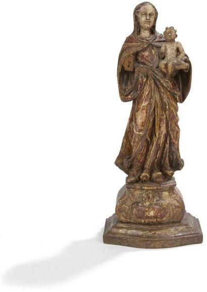 Groupe en bois anciennement doré et peint représentant la Vierge à l'Enfant; socle...