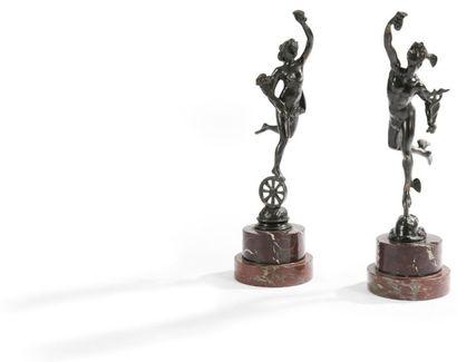 Mercure et l'Abondance en bronze patiné, reposant sur socles circulaires en marbre...