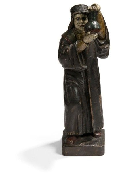 Saint Côme en bois sculpté et polychromé....