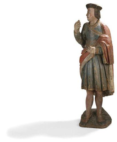 Saint Yves (?) en noyer sculpté, doré et...