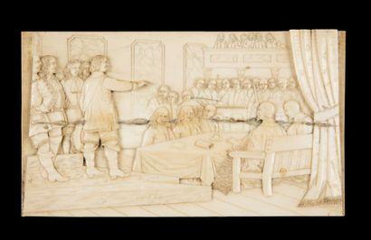 Bas-relief en ivoire sculpté représentant une assemblée d'hommes en costume du XVIIe....
