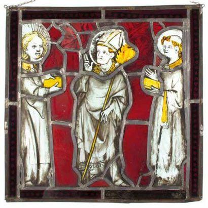 Saint Evêque bénissant flanqué de deux personnages...