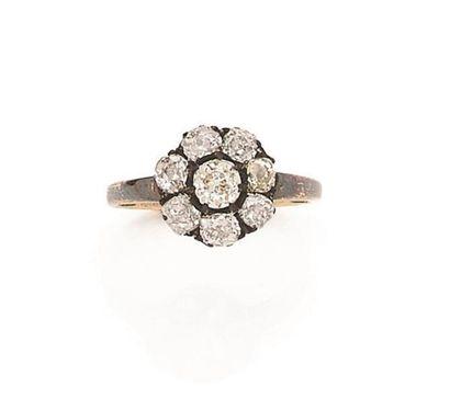 Bague en or et argent, ornée de 8 diamants...