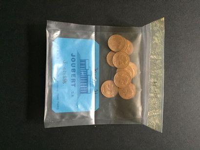 10 pièces de 20 Francs en or dans un sachet...