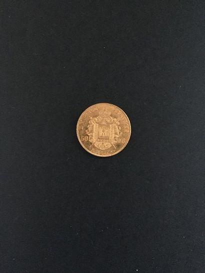 1 pièce de 50 Francs en or dans un sachet...