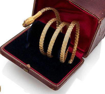 Bracelet armille en or 18K (750) tressé représentant...