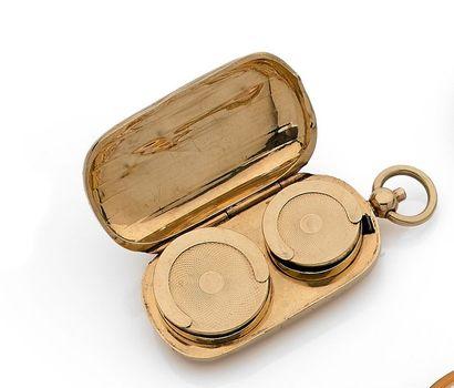 Porte-Louis en or. Hauteur totale : 6,5 cm...