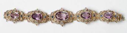 Bracelet en argent articulé de 5 motifs feuillagés,...