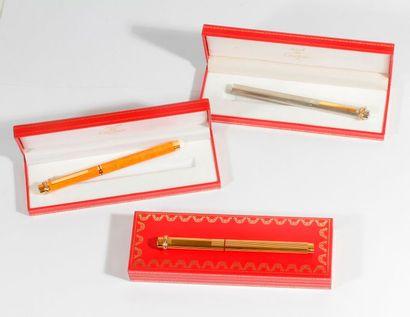CARTIER, 3 stylo-bille Must en plaqué or,...