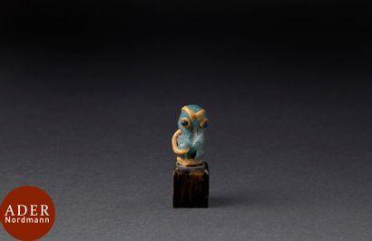 Figurine représentant un babouin stylisé....