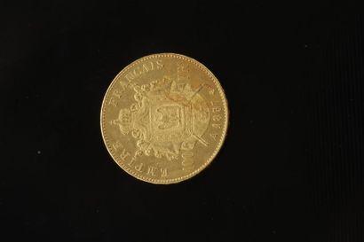 1 pièce de 100 Francs en or dans un sachet...