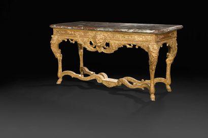 Table console en bois doré, le dessus de...