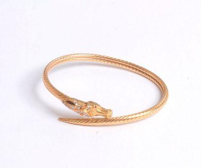 Bracelet en or 18K (750) à décor de chevron,...
