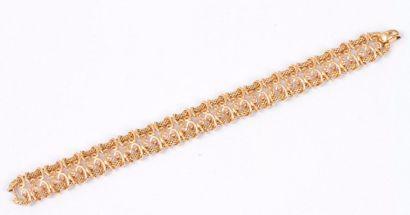 Bracelet ruban ajouré en or 18K (750). Longueur...