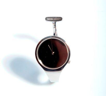 TORUN pour GEORG JENSEN. Montre asymétrique en acier, fond miroir, index muet, mouvement...