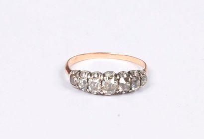 Bague en or 18K (750), ornée de 7 diamants...