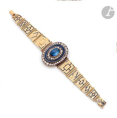 Bracelet en or 14K (585) et argent , articulé...