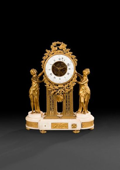 Pendule à quantièmes en bronze doré et marbre...