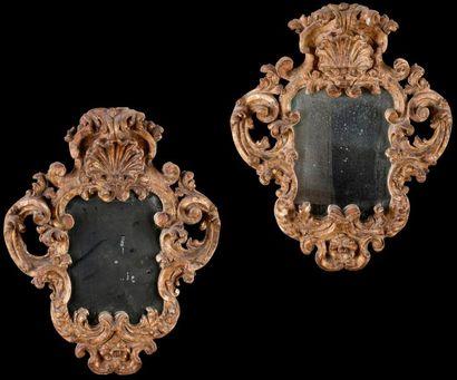 Paire de miroirs porte-lumière en bois doré...