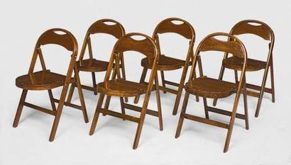 Série de six chaises pliantes en teck,assises...
