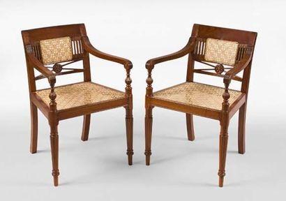 Paire de fauteuils en teck et canne. Provenance...