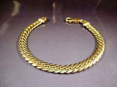 Bracelet en or jaune maille anglaise Poids...