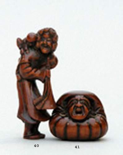 NETSUKE en bois représentant un Hollandais...