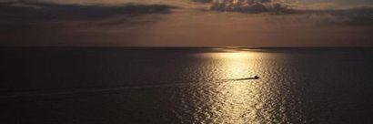 Couché de soleil. Format : 80 x 260 cm. Photographe...