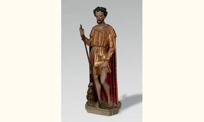 Saint Roch en bois sculpté, doré et polychromé....