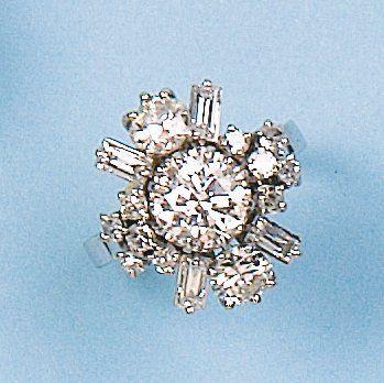 Bague en or gris et platine ornée d'un diamant...