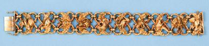 Bracelet articulé en or jaune à décor de...