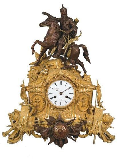 Pendule en bronze ciselé et doré et bronze...