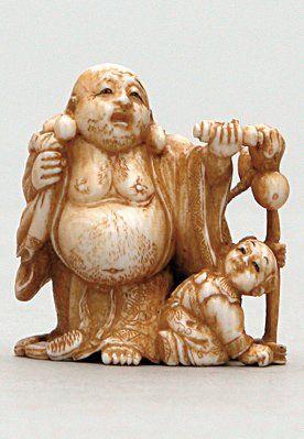 NETSUKE en ivoire représentant Hoteï portant...