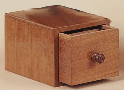 Boîte tiroir. Cette boîte préalablement montrée...