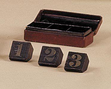 Boîte à divination. Le spectateur compose...