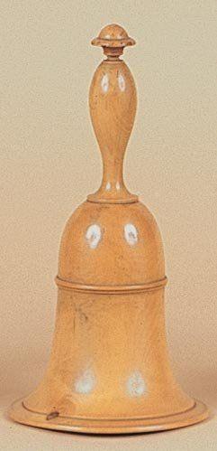 Cloche au millet. Une cloche en buis, apparemment...
