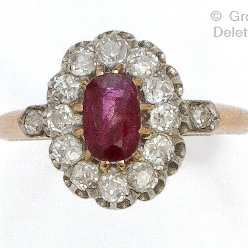 """Yellow gold """"Pompadour"""" ring set with an oval ruby in a setting of old cut diamo…"""