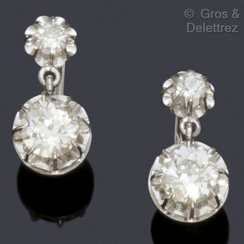 "A pair of white gold ""Dormeuses"" earrings, each set with an old cut diamond and …"