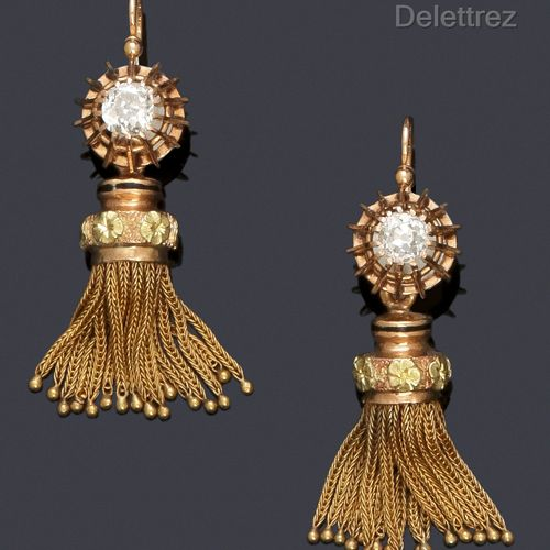 A pair of yellow gold earrings, each with an old cut diamond supporting a pompom…