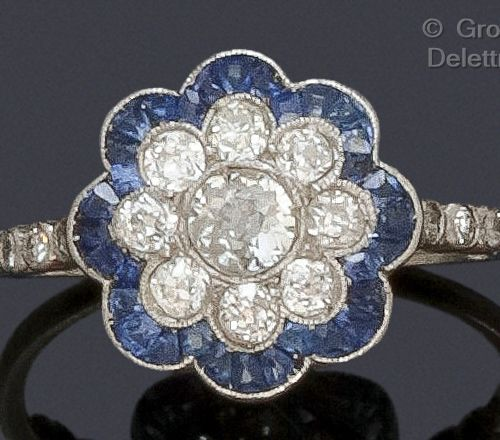 "A platinum ""Flower"" ring with poly lobed decoration, set with an old cut diamond…"