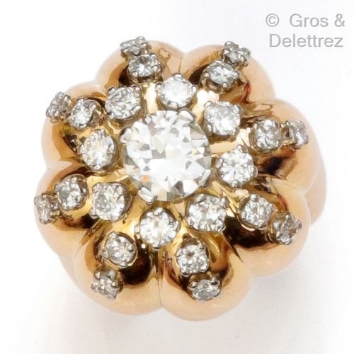 "A yellow gold ""Boule"" ring, set with an old cut diamond underlined by brilliant …"